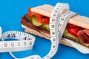 Healthy sandwich and measuring tape