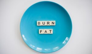 Burn fat text on a blue plate